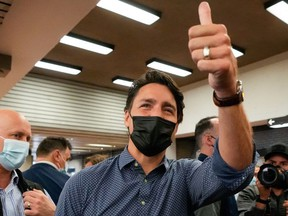 Canada's Liberal Prime Minister Justin Trudeau gestures as he greets supporters, after the Liberals won a minority government, at the Jarry Metro station in Montreal, Quebec, Canada, September 21, 2021.