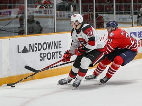 Ottawa 67's defenceman Jack Matier keeps the puck away from Oshawa Generals winger Daniel Michaud during an Ontario Hockey League game yesterday at TD Place in Ottawa. The 67's won 7-3.