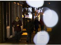 Pedestrians make their way down Whyte Avenue, Edmonton's popular nightlifes strip, in October. The province is requiring restaurants and bars to close at 11 p.m. for two weeks.