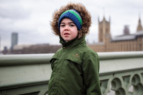 FILE: Six-year-old Alfie Dingley poses on Westminster Bridge. /