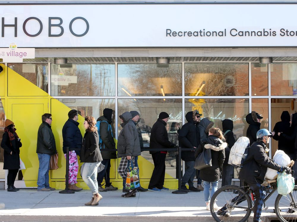 FILE: People line up outside the Hobo Recreational Cannabis Store on Bank Street April 1, the first day legal pot shops opened in Ottawa.