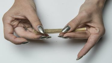 Person-rolling-joint