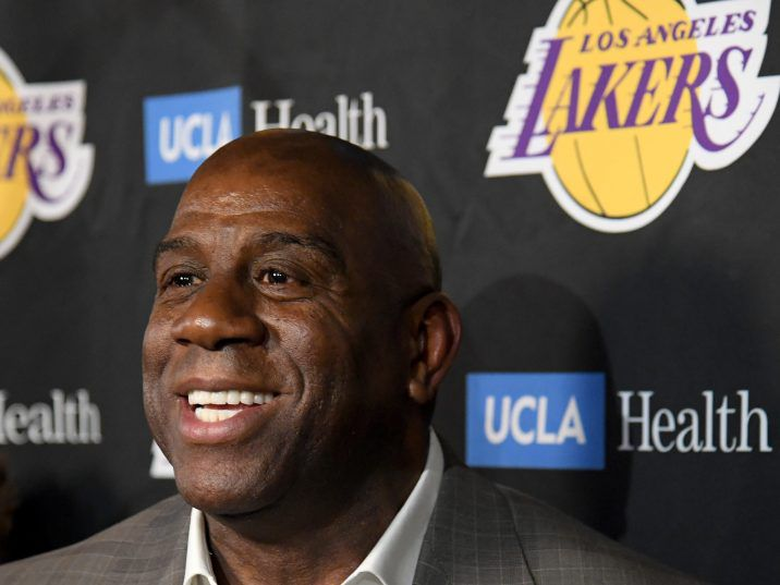 FILE: Magic Johnson reacts as he speaks to the press resigning as Los Angeles Lakers President of Basketball Operations before the game against the Portland Trail Blazers at Staples Center on Apr. 09, 2019 in Los Angeles, Calif.