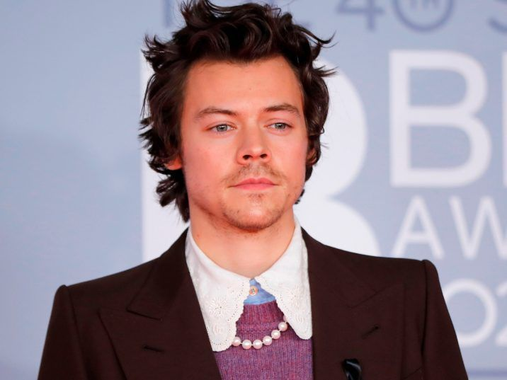 FILE: British singer-songwriter Harry Styles poses on the red carpet on arrival for the BRIT Awards 2020 in London on Feb. 18, 2020.