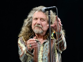 British singer Robert Plant performs on the Pyramid Stage, on the second day of the Glastonbury Festival of Music and Performing Arts in Somerset, southwest England, on June 28, 2014.