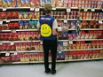 TROY, OH - MAY 11: An employee restocks a shelf in the grocery section of a Wal-Mart Supercenter May 11, 2005 in Troy, Ohio.