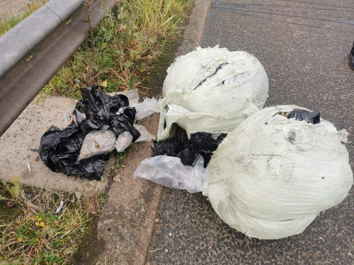 The weed was found wrapped in plastic trash bags near the Black Road junction early Saturday morning.