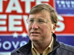 """FILE: Mississippi Lieutenant Governor and Republican Gubernatorial candidate Tate Reeves speaks to reporters before appearing with President Donald Trump at a """"Keep America Great"""" campaign rally at BancorpSouth Arena on Nov. 1, 2019 in Tupelo, Miss."""