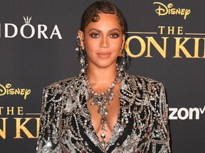 "FILE: U.S. singer/songwriter Beyonce arrives for the world premiere of Disney's ""The Lion King"" at the Dolby theatre on July 9, 2019 in Hollywood. /"