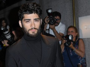 FILE: Zayn Malik arrives for the Tom Ford Autumn/Winter 2016 Menswear and Womenswear Collection presentation in New York on Sept. 7, 2016. /