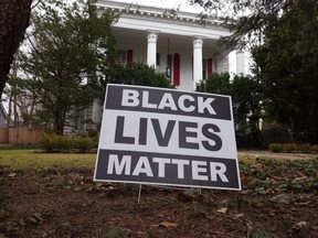 FILE: A Black Lives Matter sign sits in front of a home on Mar. 23, 2021 in Evanston, Ill. The City Council of Evanston voted yesterday to approve a plan, which may be the first of its kind in the nation, to make reparations available to Black residents due to past discrimination. /