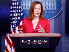 FILE: White House press secretary Jen Psaki holds a press briefing in Washington, March 11, 2021.