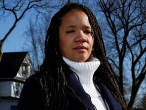 FILE: Evanston Alderman Robin Rue Simmons, who spearheaded the city's reparations initiative, poses near her home in the Fifth Ward in Evanston, Ill. /