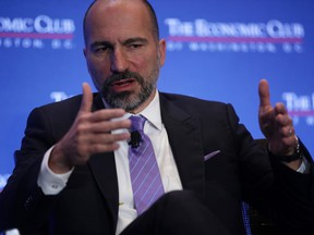 FILE: Uber CEO Dara Khosrowshahi participates in a discussion during a breakfast event of The Economic Club of Washington June 11, 2019 in Washington, DC. /