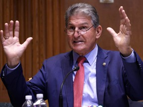 FILE: U.S. Sen. Joe Manchin (D-WV) speaks during a hearing before Transportation, Housing and Urban Development, and Related Agencies Subcommittee of Senate Appropriations Committee at Dirksen Senate Office Building June 10, 2021 on Capitol Hill in Washington, DC.