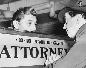 Robert Mitchum, who served 50 days in jail on a marijuana conviction, talks with attorney Jerry Geisler about his release on March 29, 1949.