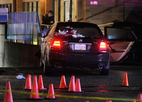 Police investigate a shooting scene at the King George Centre shopping mall at 100th Avenue and King George Boulevard in Surrey, B.C. October 22, 2011. (Ric Ernst/PNG)
