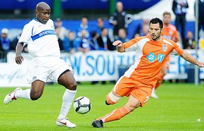 Former RailHawks forward Etienne Barbara (R) signed with the Whitecaps on Tuesday. In action here against ex-Whitecap Nelson Akwari.