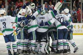 DETROIT, MI - FEBRUARY 23:  The Vancoucer Canucks celebrate their shootout win ending the Detroit Red Wings 23 game home winning streak after an NHL game at Joe Louis Arena on February 23, 2012 in Detroit, Michigan.  Vancouver wins 4-3 in shootout. (Photo by Dave Reginek/NHLI via Getty Images)