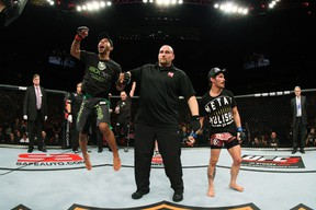 SYDNEY, AUSTRALIA - MARCH 03:  Demetrious Johnson (L) reacts after winning a decision over Ian McCall (R) in a flyweight bout during the UFC on FX event at Allphones Arena on March 3, 2012 in Sydney, Australia.  (Photo by Josh Hedges/Zuffa LLC/Zuffa LLC via Getty Images)