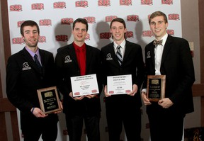 TWU's Fearsome Foursome (left to right) Jarrod Offereins, coach Ben Josephson, Ben Ball and Rudy Verhoeff cleaned up at the CIS awards breakfast on Thursday. (CIS photo)