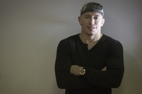 UFC (Ultimate Fighting Championship) Welterweight Champion Georges St-Pierre of Canada poses on November 7, 2011 in Issy-les-Moulineaux, a neighboring suburb of Paris. (Photo by JOEL SAGET/AFP/Getty Images)