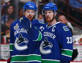 Canucks leaders Henrik and Daniel Sedin point the way to the 2013 TV schedule.