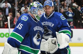 Who starts? Cory Schneider, left, or Roberto Luongo? (Photo: Jeff Vinnick/Getty Images)