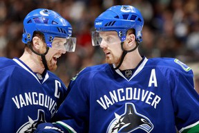 Henrik and Daniel Sedin have signed a four-year contract extension with the Canucks.