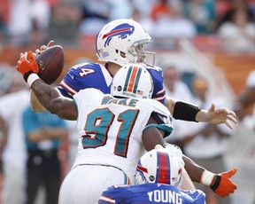 Miami Dolphins' Cameron Wake goes after Buffalo Bills QB Ryan Fitzpatrick in December 2012. Getty Images file photo.