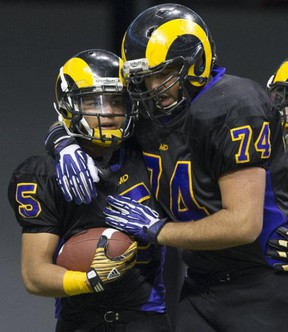 Mt. Douglas Rams' running back Marcus Davis (left) shares a moment with offensive lineman Aarmin Purewal during Saturday's Subway Bowl finals win over Terry Fox at BC Place. (Gerry Kahrmann, PNG photo)