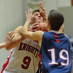 Andrew Golin (left) and the rest of the St. Thomas More Knights face the Sutherland Sabres in Elite 8 action today at the LEC. (Jason Payne, PNG)