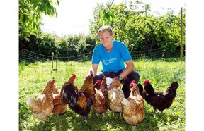 Jordan Maynard with chickens at Southlands Heritage Farm. Maynard has offered to take in unwanted chickens, but says there seems little need for the service.