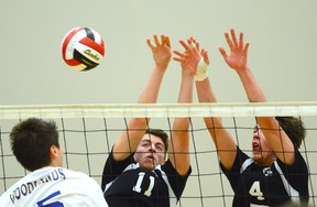 Kohl Linder (11) and Spencer Kingzett (4) of Penticton's Princesss Margaret Mustangs share a block against Vancouver Island champion Woodland Eagles of Nanaimo during their opening match at the B.C. Senior boys Double A volleyball championships Wednesday at the Langley Events Centre. After surviving a bus crash Tuesday, the Mustangs arrived just in time for a match they would go on to win 2-1 (15-25, 28-18, 15-12).