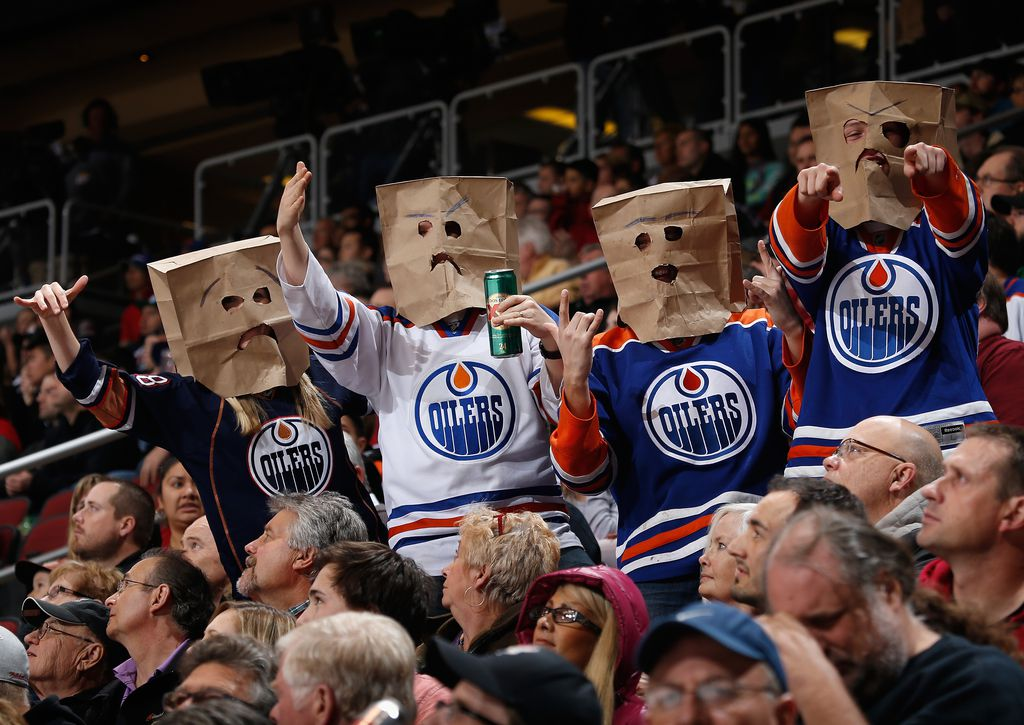 GLENDALE, AZ - DECEMBER 16:  Fans of the Edmonton Oilers wearing bags on their heads react during the NHL game against the Arizona Coyotes at Gila River Arena on December 16, 2014 in Glendale, Arizona. The Coyotes defeated the Oilers 2-1 in an overtime shootout.  (Photo by Christian Petersen/Getty Images)