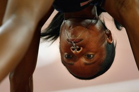 Muna Lee, pictured in the blocks of 200m heats at 2008 Beijing Olympics, runs in the Canadian University Invitational Friday in Langley. (Getty Images)