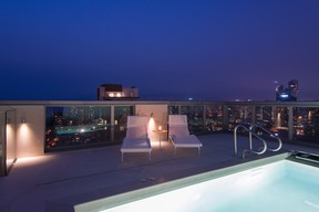 The outdoor space and private pool of the penthouse at the Maddox