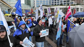 Delegates rallied outside the B.C. Federation of Labour convention in Dec. 2014, calling for a $15 per hour minimum wage for B.C. workers.