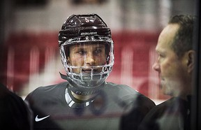 Jakob Chychrun talks to head coach Dave Lowry during a Canadian World Junior Hockey team practice in Toronto on Thursday.