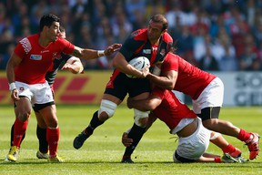 Georgia captain Mamuka Gorgodze is tackled by the Tonga defence during the 2015 Rugby World Cup.