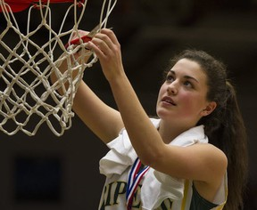 Argyle Pipers' Georgia Swant cuts down the victorious net after the North Vancouver school won the Telus BC junior girls basketball championship Saturday at the Langley Events Centre. (PNG photo)