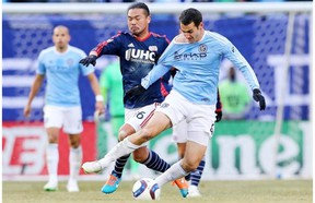Andrew Jacobson, right, of New York City FC gets a tug from former Whitecap Daigo Kobayashi of the New England Revolution last season. Jacobson, obtained by the Caps for targeted allocation money, should be ready to play for Vancouver Saturday in Seattle.