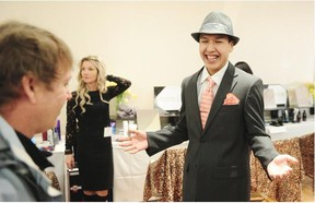 Britannia high school student Austin Charlie smiles after picking out a new suit, shoes, shirt, tie and fedora.   — Nick Procaylo/PNG
