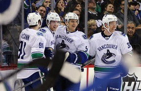 From left: Jared McCann, Ben Hutton, Luca Sbisa and Jannik Hansen -- all of whom figure prominently in our end-of-season Canucks survey -- celebrate a goal in Brooklyn before presumably heading out to some hipster eatery.