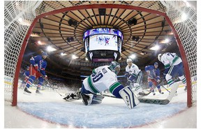 Henrik Sedin #33 of the Vancouver Canucks gets injured during the game against the New York Islanders at the Barclays Center on January 17, 2016 in Brooklyn borough of New York City.