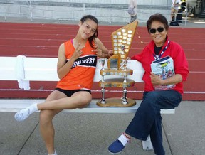 Nina Schultz and her grandma, Zheng Fengrong, celebrate Schultz's second straight Top Female Athlete award at last spring's BC high school championships. (Schultz family)