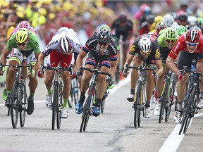 Germany's Andre Greipel, right, crosses the finish line ahead of Peter Sagan of Slovakia, left, Norway's Alexander Kristoff, second left, and Germany's John Degenkolb, center, to win the the fifteenth stage of the 2015 Tour de France.