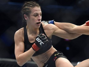 Joanna Jedrzejczyk, left, competes against Valerie Letourneau during their UFC 193 strawweight title fight in Melbourne, Australia, Sunday, Nov. 15, 2015.