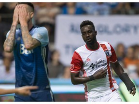 David Edgar of the Vancouver Whitecaps, like a lot of his team's fans, couldn't watch after San Jose Earthquakes' Simon Dawkins, right, scored on Saturday at B.C. Place. The visitors won 2-1.