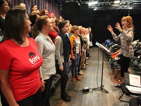 Sing City choir members learn how to 'open wide' under the instruction of Laura Lang.